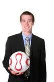 Homem de negócio com esfera de futebol (futebol) imagens de stock royalty free