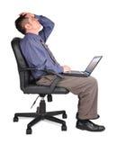 Homem de negócio com esforço de Compter Fotos de Stock Royalty Free