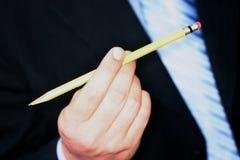 Homem de negócio com lápis foto de stock
