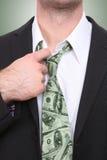 Homem de negócio com laço do dinheiro Imagens de Stock Royalty Free