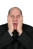 Homem de negócio com mãos até a face Fotos de Stock