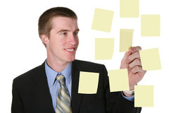 Homem de negócio com notas imagens de stock