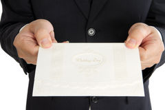 Homem de negócio com o cartão do presente na mão Fotos de Stock