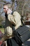 Homem de negócio com o telefone do computador portátil e de pilha Foto de Stock Royalty Free