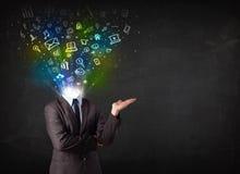 Homem de negócio com os ícones de incandescência dos meios que explodem a cabeça Foto de Stock Royalty Free