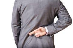 Homem de negócio com seus dedos cruzados Foto de Stock Royalty Free