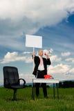 Homem de negócio com sinal do piquete Fotografia de Stock