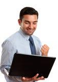 Homem de negócio com sucesso do computador portátil, vitória Fotos de Stock Royalty Free