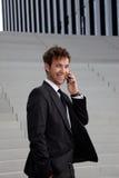Homem de negócio com telefone Foto de Stock Royalty Free