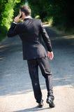 Homem de negócio com telefone Fotos de Stock Royalty Free