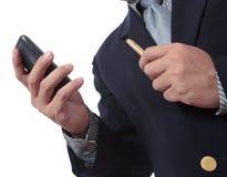 Homem de negócio com telefone móvel Fotos de Stock