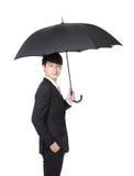 Homem de negócio com um guarda-chuva imagens de stock royalty free