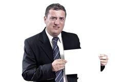 Homem de negócio com um papel nas mãos Imagens de Stock Royalty Free