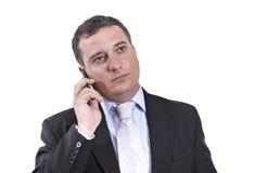 Homem de negócio com um telefone móvel Imagem de Stock