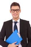 Homem de negócio com uma prancheta Fotografia de Stock Royalty Free