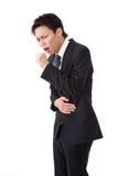 Homem de negócio com uma tosse Imagem de Stock