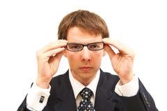 Homem de negócio com vidro Fotos de Stock Royalty Free