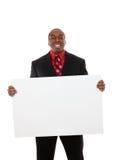 Homem de negócio considerável com sinal Imagens de Stock