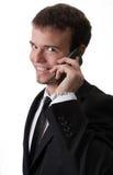 Homem de negócio considerável com telefone Fotografia de Stock Royalty Free