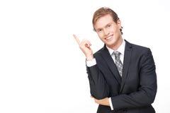 Homem de negócio considerável novo que aponta acima foto de stock royalty free