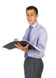 Homem de negócio da leitura de Smilling fotos de stock royalty free