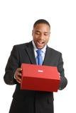 Homem de negócio do americano africano que esvazia a caixa Fotos de Stock