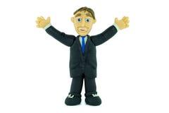 Homem de negócio do sucesso que sorri no plasticine imagem de stock royalty free