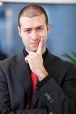 Homem de negócio duvidoso no escritório Imagens de Stock Royalty Free