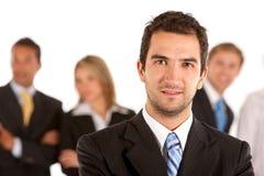 Homem de negócio e sua equipe Foto de Stock Royalty Free