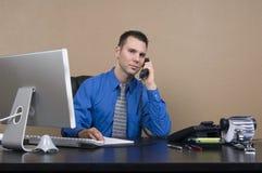 Homem de negócio em seu escritório Imagem de Stock Royalty Free