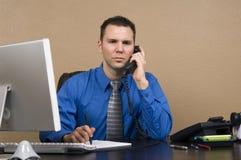 Homem de negócio em seu escritório Imagens de Stock