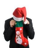 Homem de negócio em um chapéu de Santa Foto de Stock