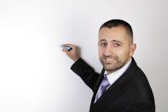 Homem de negócio em uma escrita do terno Fotografia de Stock Royalty Free