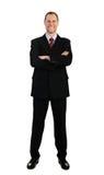 Homem de negócio ereto no terno isolado no branco Imagem de Stock