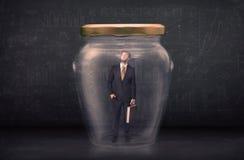 Homem de negócio fechado em um conceito de vidro do frasco Foto de Stock Royalty Free