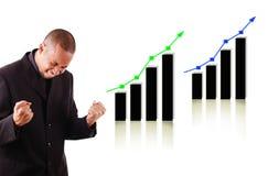 Homem de negócio feliz com dois gráficos de aumentação imagem de stock royalty free
