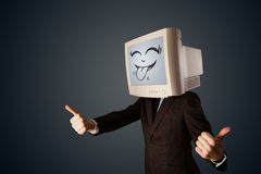 Homem de negócio feliz com um monitor do computador e uma cara do smiley Imagens de Stock