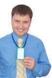 Homem de negócio feliz que mostra seu emblema Fotos de Stock