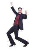 Homem de negócio gesticulando bem sucedido feliz fotografia de stock royalty free