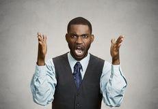 Homem de negócio irritado que grita imagem de stock royalty free