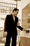 Homem de negócio na cabine de bilhete Imagem de Stock Royalty Free