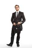 Homem de negócio na posição do terno Fotos de Stock