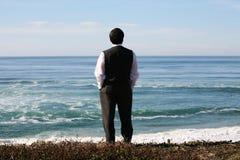 Homem de negócio na praia Fotos de Stock
