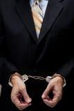 Homem de negócio nas algemas Imagem de Stock Royalty Free