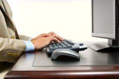 Homem de negócio no computador Foto de Stock Royalty Free