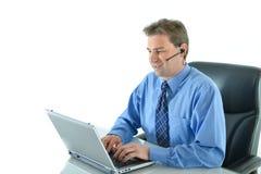 Homem de negócio no funcionamento do telefone Fotos de Stock Royalty Free