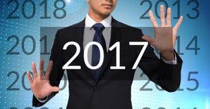 Homem de negócio no fundo digitalmente gerado que toca em 2017 Imagens de Stock