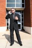 Homem de negócio no telefone fora Fotografia de Stock