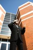 Homem de negócio no telefone fora Fotos de Stock Royalty Free