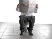 Homem de negócio no toalete Imagens de Stock